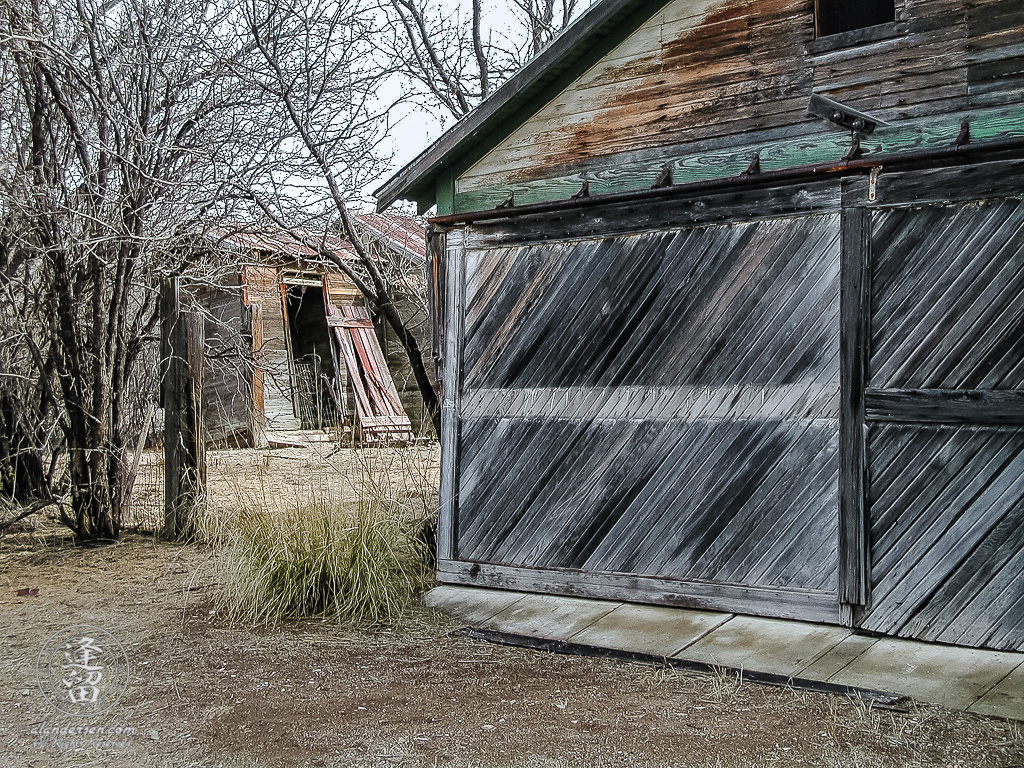 Old green wooden barn at ghost town of Fairbank, Arizona.