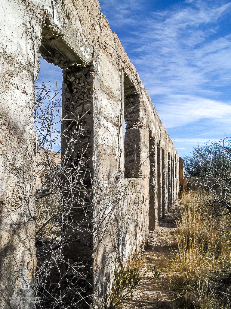 The still-standing concrete wall of the school in the ghost town of Gleeson, Arizona.