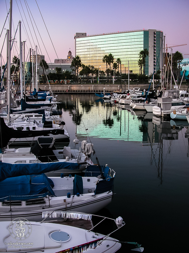 Hyatt Regency reflected in Shoreline Village Marina waters.