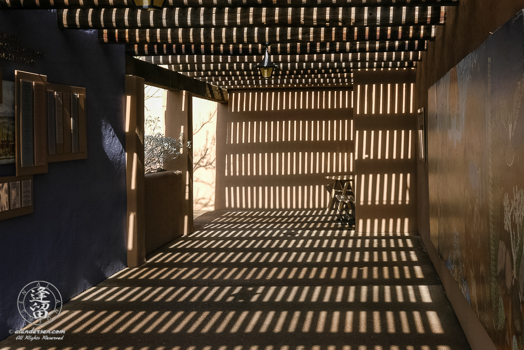 Sunlight and shadow create dizzy patterns on walls.