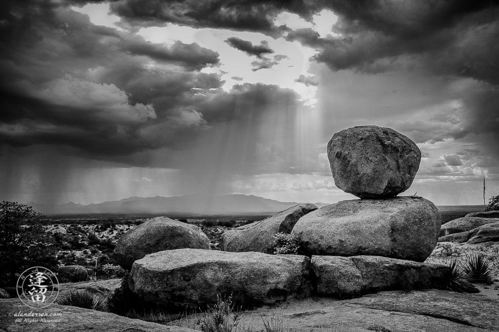 Summer Monsoon rainstorm sweeping across a desert valley.