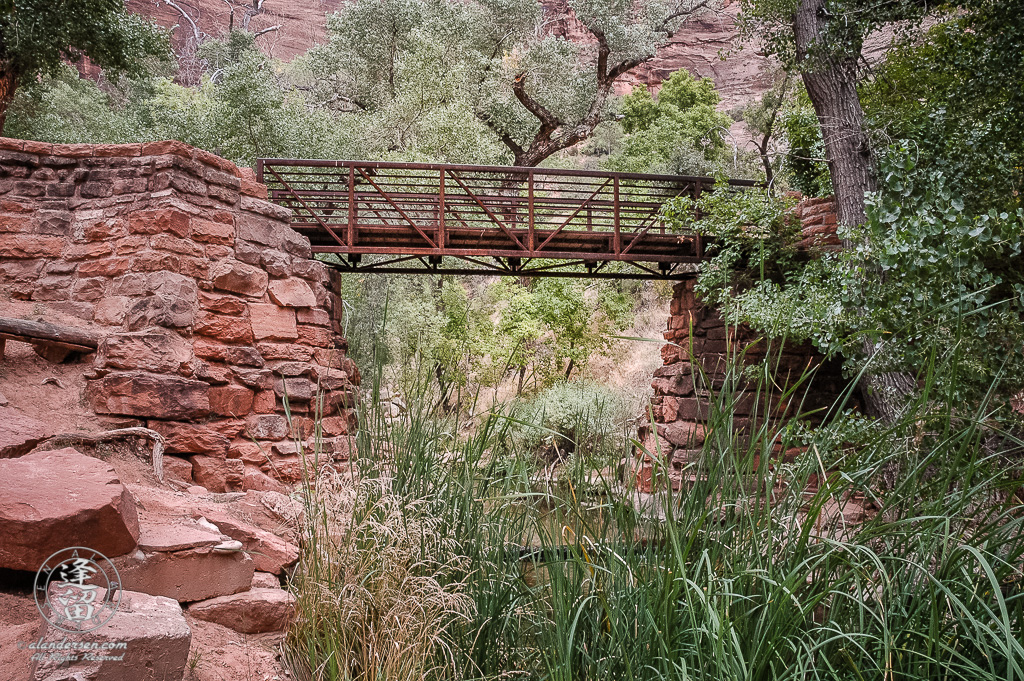 Brick foot bridge spanning creek below Weeping Rock at Zion National Park in Utah.