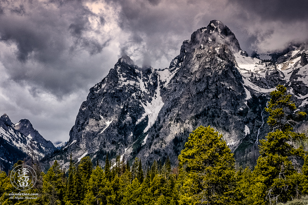 A Summer storm brewing over Symmetry Spire and Storm Point in Grand Teton National Park, Wyoming.