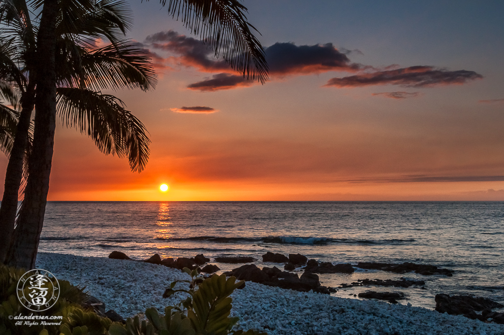 Hawaiian sunset and coral beach at waikoloa.