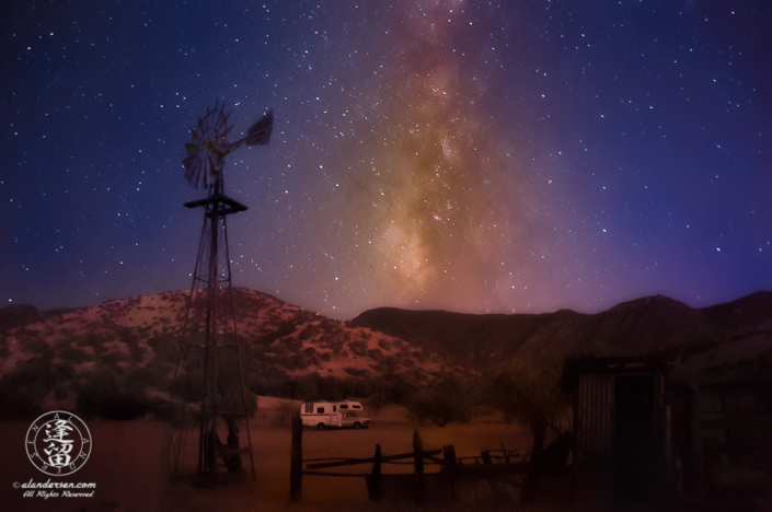 Milky Way rising into dark purple evening sky.