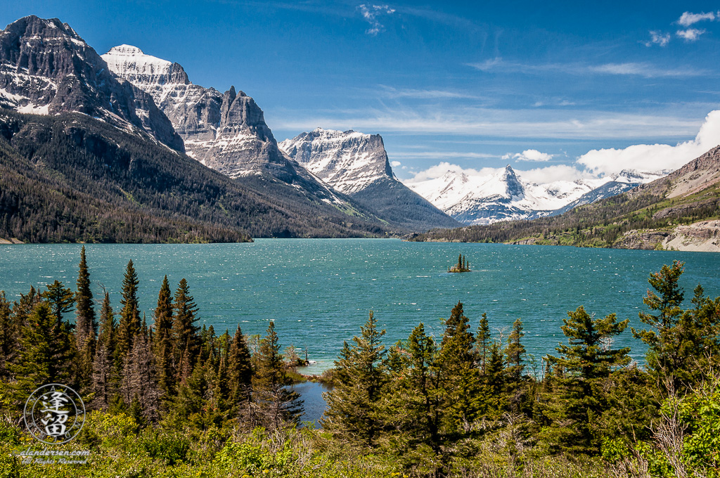 Wild Goose Island and the snow-clad mountain peaks that surround St. Mary's Lake.
