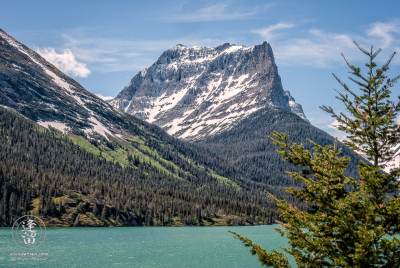 Mount Dusty Star rising majestically by Saint Mary's lake.