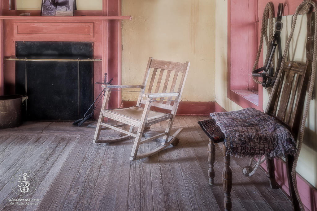 A rocking chair nestled between the fireplace and bedroom window at Brown Canyon Ranch in the foothills of Southeastern Arizona's Huachuca Mountains.