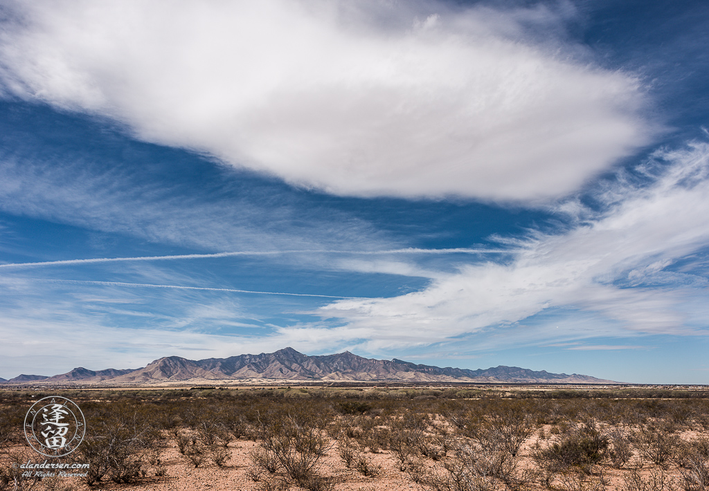 Cirrus clouds streaming above Arizona's Huachuca Mountains.