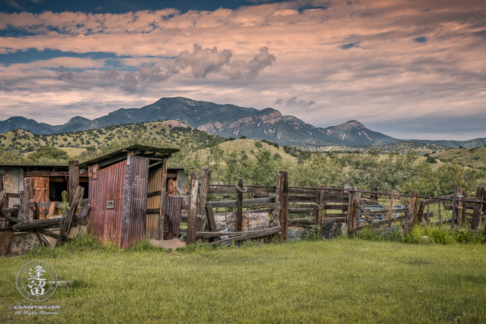 Outhouse and corrals at historic Brown Canyon Ranch with Huachuca Peak in the background.