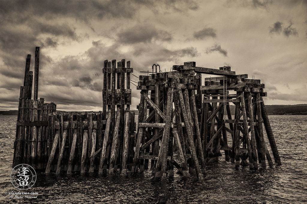 Old wooden ferry dock just off shore in historic downtown Port Townsend, Washington.