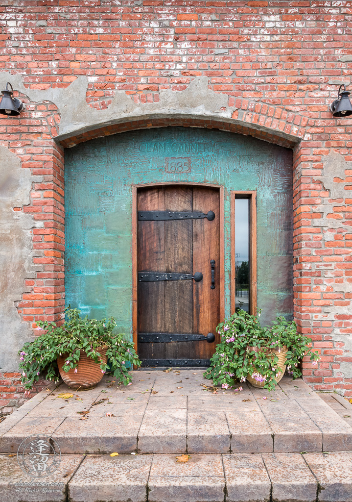Wooden door to Clam Cannery in historic Port Townsend.