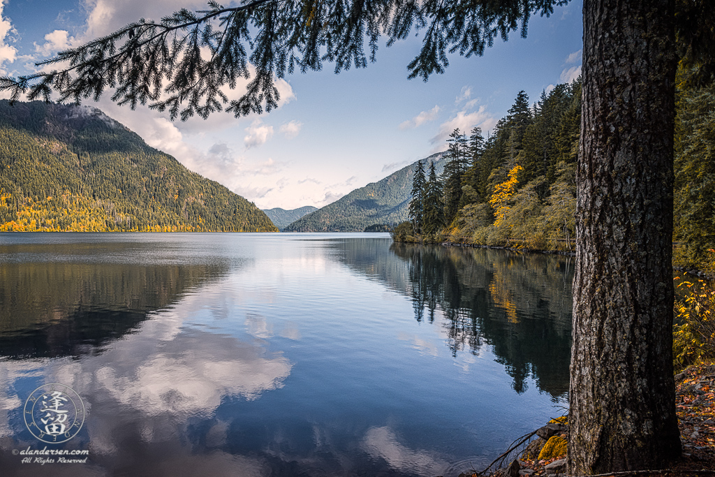 Calm pristine water reflects the forest-covered hills that surround Lake Crescent on the Olympic Peninsula in Washington.