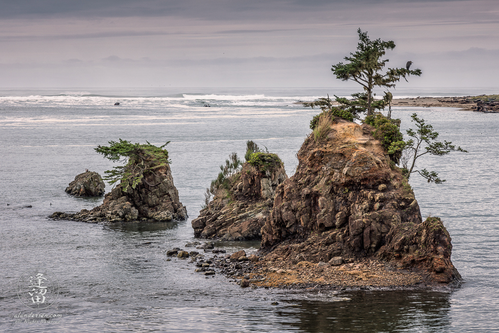 Sea Stacks rising from the water at high tide in Siletz Bay just outside of Lincoln City, Oregon.