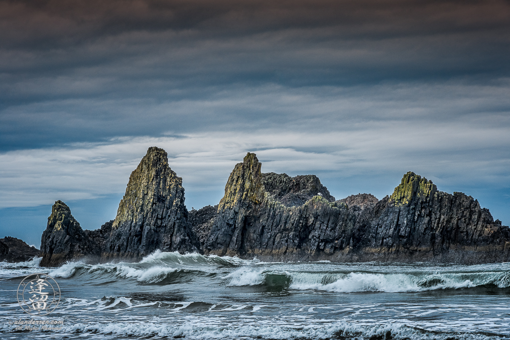 Morning Sun paints tips of jagged rock formations at Seal Rock State Wayside in Oregon.