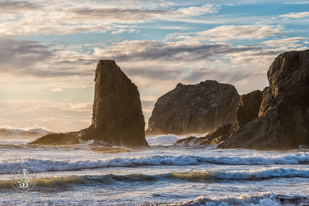 The golden rays of sunset illuminate the sea stacks at Bandon Beach near Gravel Point in Oregon.