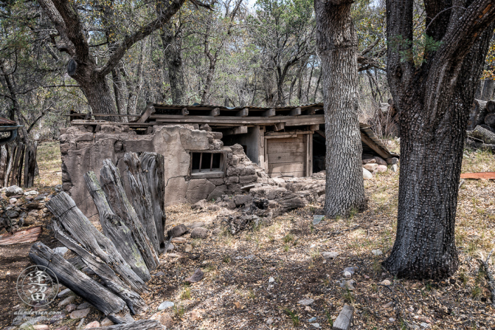 Adobe storage building built into side of hill that served as jail and root cellar at Camp Rucker in Arizona.