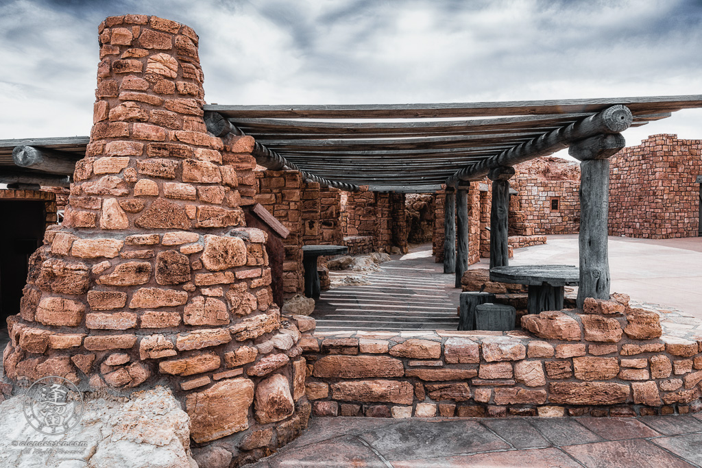 An outdoor Kiva stove and tables beneath a ramada at the Navajo Bridge Interpretive Center in Marble Canyon, Arizona.