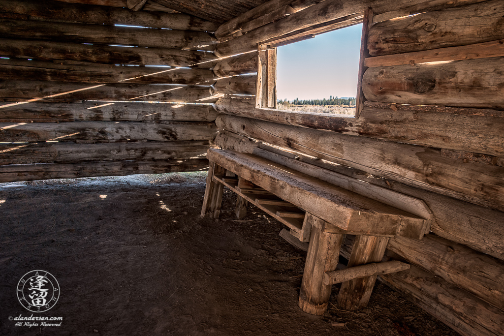 Wide-angle interior view of historical J. Pierce Cunningham Cabin in Grand Teton National Park, Wyoming.