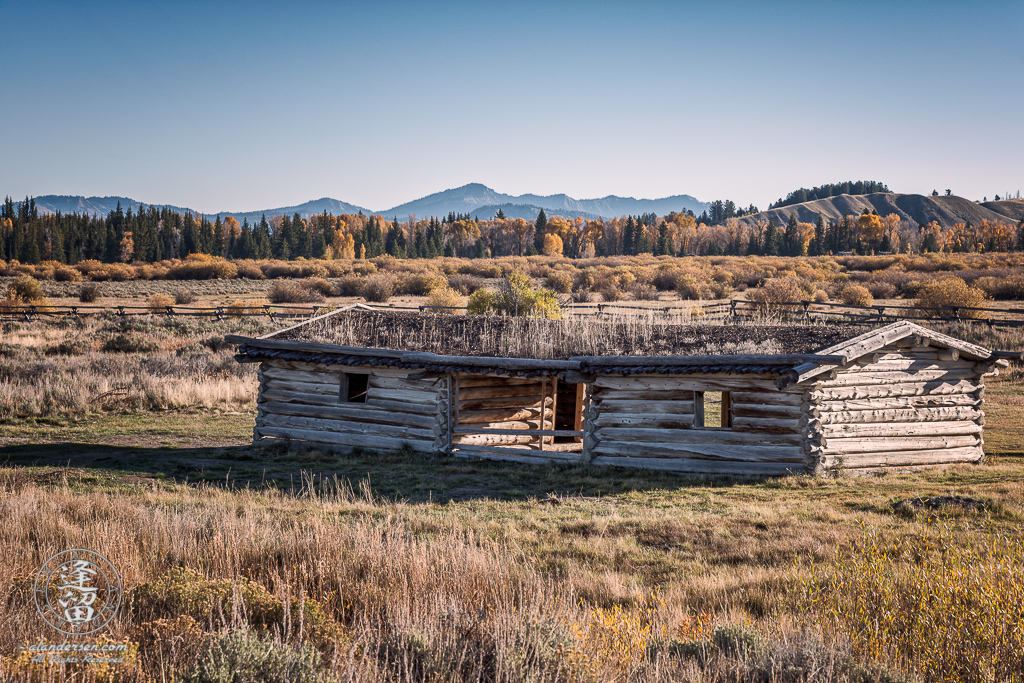 Exterior landscape view of historical J. Pierce Cunningham Cabin in Grand Teton National Park, Wyoming.