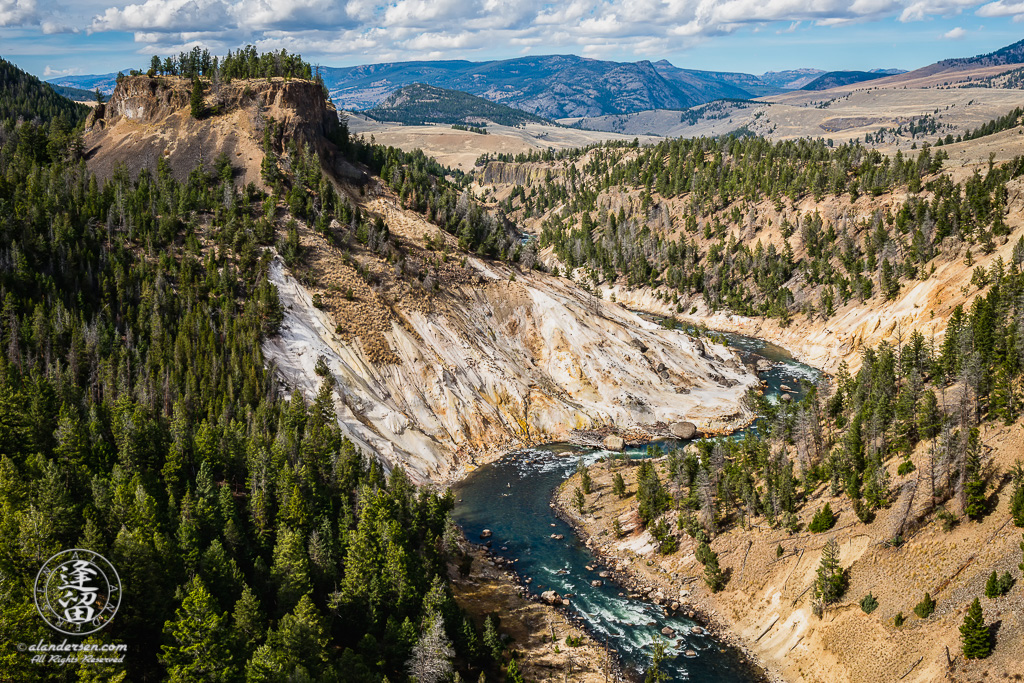 Milky-white Calcite Springs hydrothermal feature on the Yellowstone River.