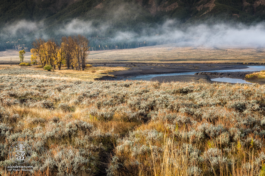Clouds hanging low in Yellowstone National Park's Lamar Vally on a sunny but cold Autumn morning.