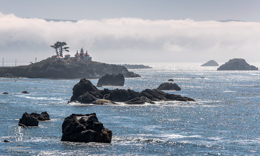 High-contrast view of Battery Point Lighthouse at Crescent City Bay in Northern California.