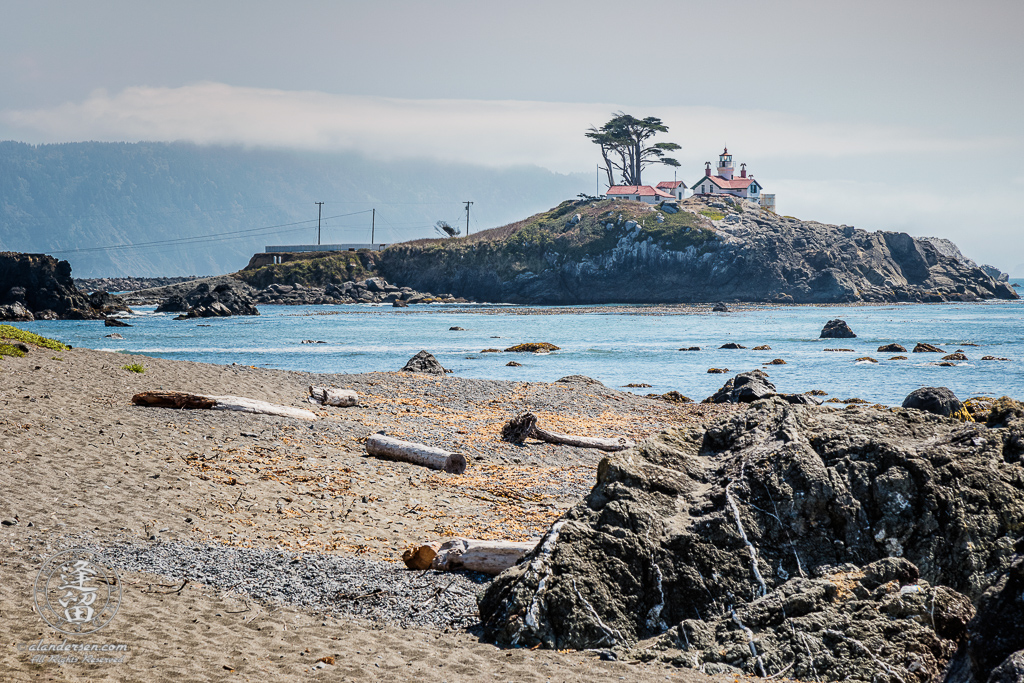 Battery Point Lighthouse seen from road-side beach at Crescent City in Northern California.
