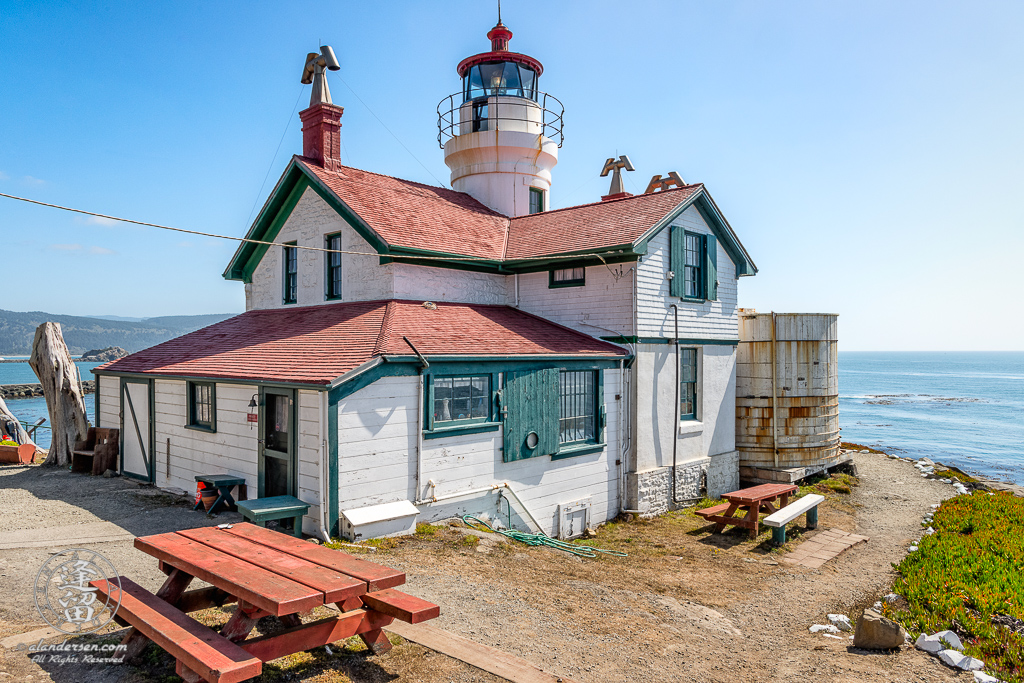 Side and rear view of Battery Point Lighthouse sitting atop hill at Crescent City in Northern California.