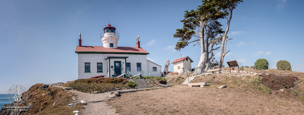 Panoramic view of Battery Point Lighthouse sitting atop hill at Crescent City in Northern California.
