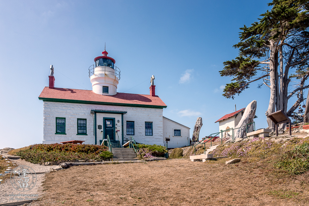 Front view of Battery Point Lighthouse sitting atop hill at Crescent City in Northern California.