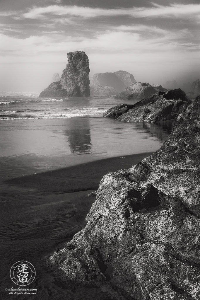 Various sea stacks at Bandon Beach in Oregon on a misty afternoon.