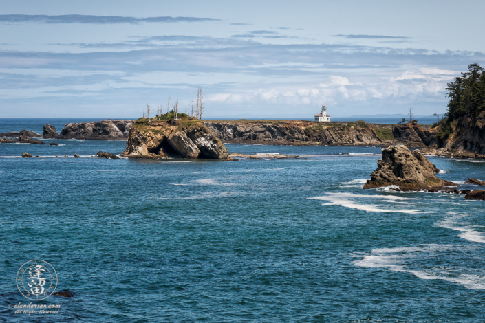 Cape Arago Lighthouse, seen from the other side of Sunset Bay on the Pacific Coast Trail to Shore Acres.
