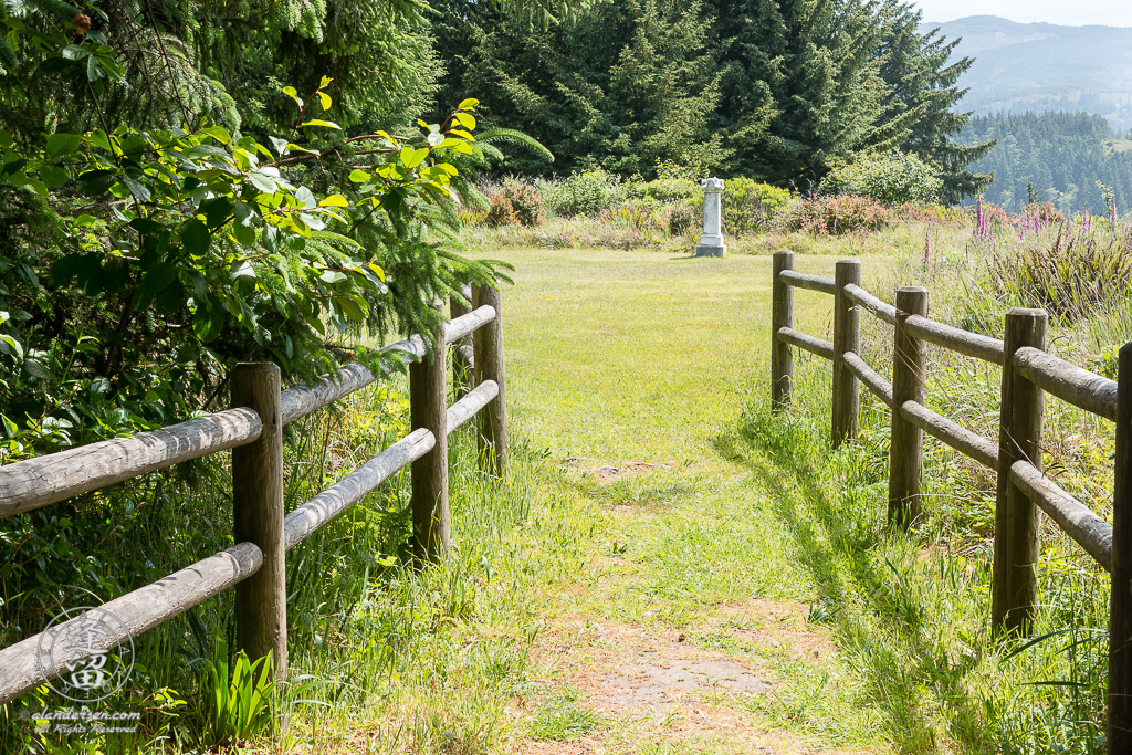 Fenced footpath leading to the Cape Blanco Pioneer Cemetery outside of Port Orford in Oregon.