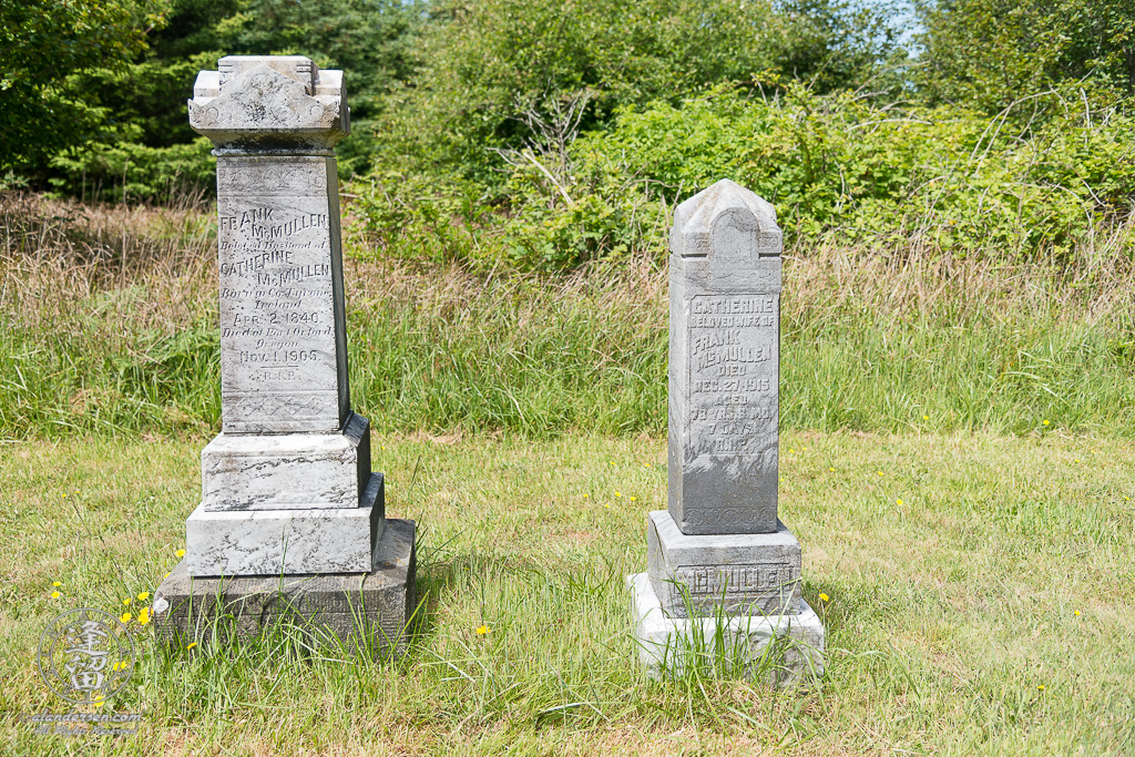 The tombstones for Frank and Catherine McMullen in the Cape Blanco Pioneer Cemetery at Cape Blanco State Park, outside of Port Orford in Oregon.