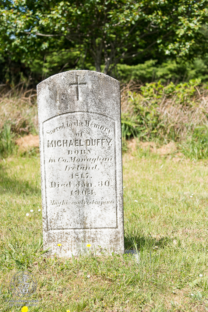 The tombstone for Michael Duffy in the Cape Blanco Pioneer Cemetery at Cape Blanco State Park, outside of Port Orford in Oregon.