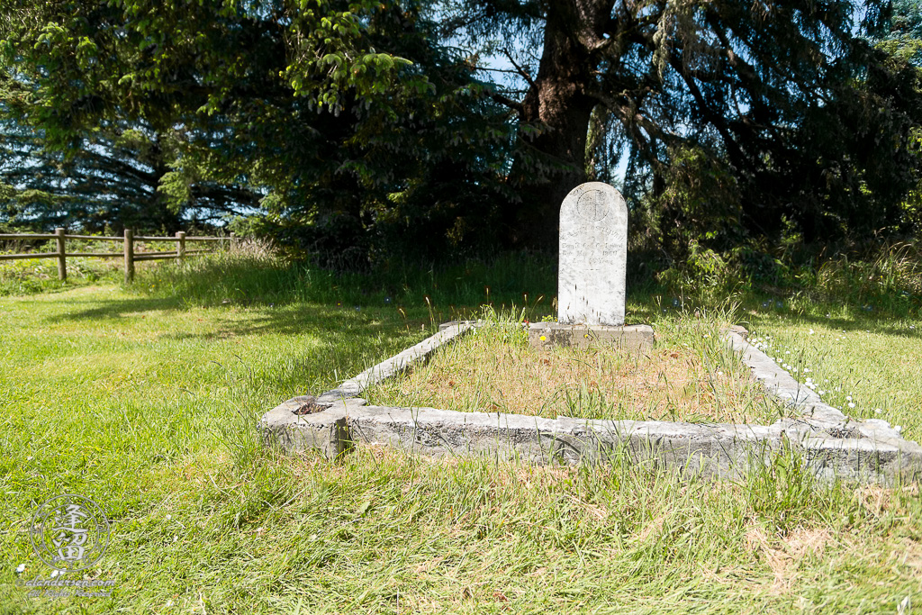 The tombstone for Willian O'Sullivan in the Cape Blanco Pioneer Cemetery at Cape Blanco State Park, outside of Port Orford in Oregon.
