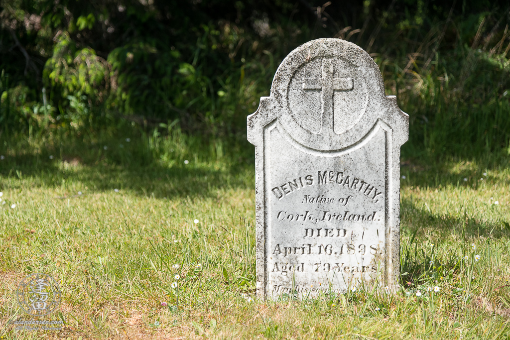 The tombstone for Denis McCarthy in the Cape Blanco Pioneer Cemetery at Cape Blanco State Park, outside of Port Orford in Oregon.