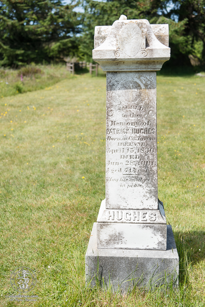 Tombstone for Hughes family patriarch, Patrick Hughes, in the Cape Blanco Pioneer Cemetery at Cape Blanco State Park, outside of Port Orford in Oregon.