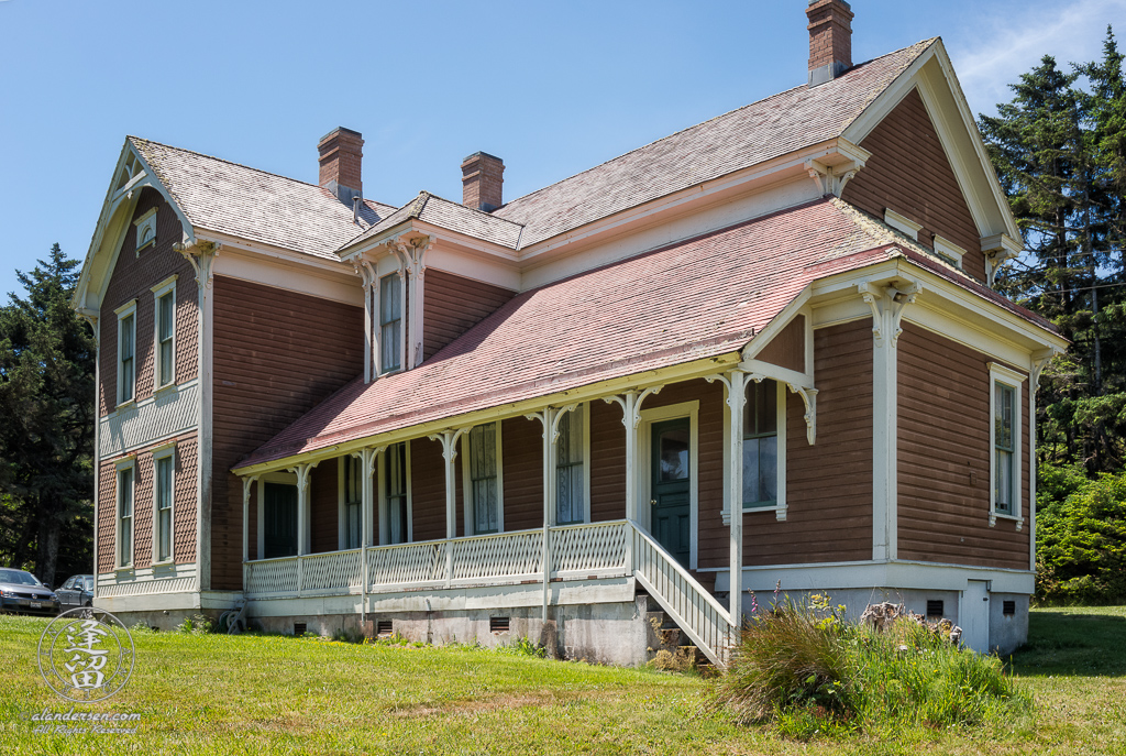 Outside view of the historic Hughes House near Port Orford, Oregon, showing porch outside kitchen.