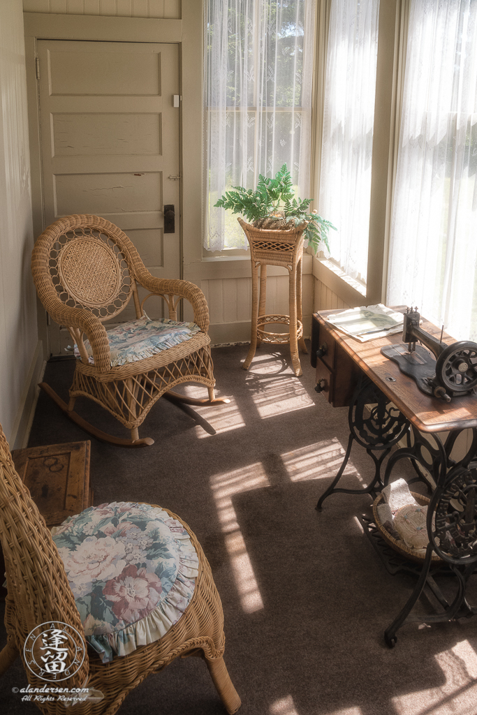 Sewing Room off the parlor in the Hughes House, a historic Victorian pioneer home near Port Orford in Curry County, Oregon.This enclosed porch area was the favorite room of Francis's wife, Annie.