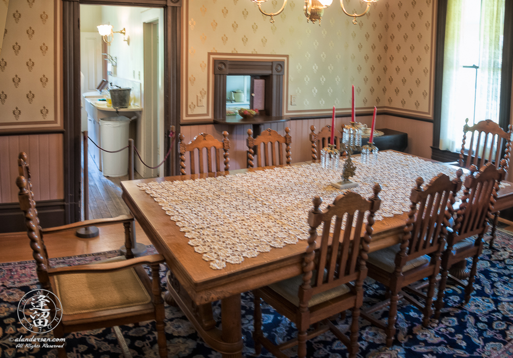 Dining Room of the Hughes House, near Port Orford, Oregon, showing the kitchen entry way.