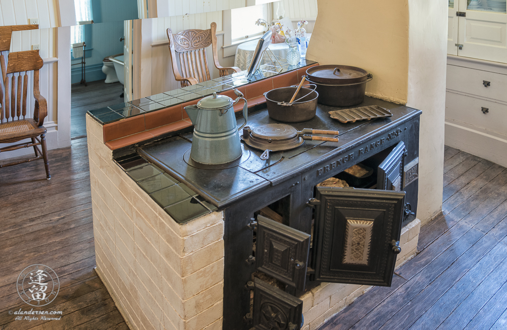 Iron free-standing stove in kitchen of Hughes Historic House near Port Orford, Oregon.