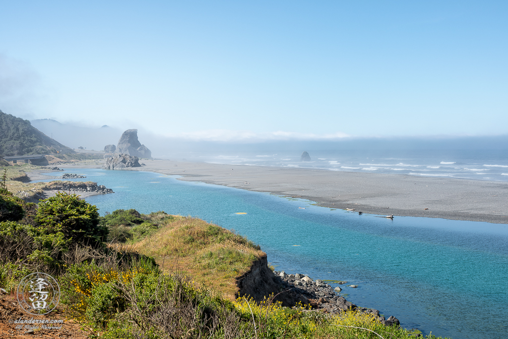 Kissing Rock on a sunny, yet misty morning South of Gold Beach in Southwestern Oregon.