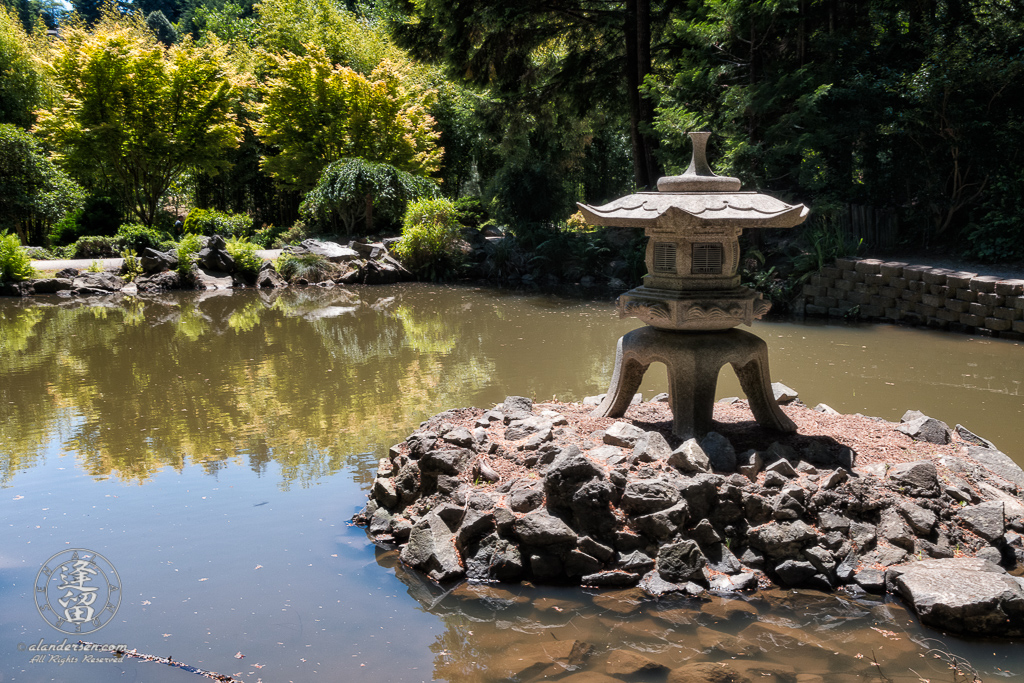 Snow Lantern on island in the Pond of Illusion in the Choshi Gardens at Mingus Park in Coos Bay, Oregon.