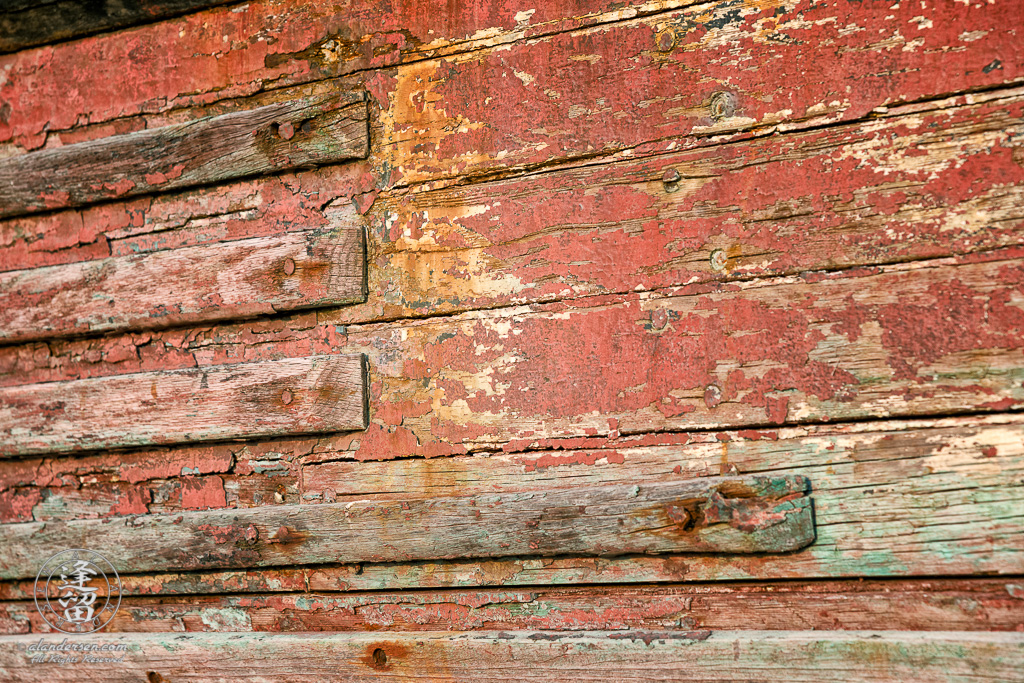 An old rusted and rotted boat in dry dock on Starfish Way, by the Marina at Crescent City in Northern California.
