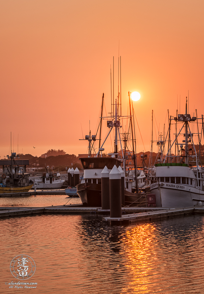 Smoke from Oregon wildfires turn the sky orange during a sunset at the Crescent City Marina in Northern California.