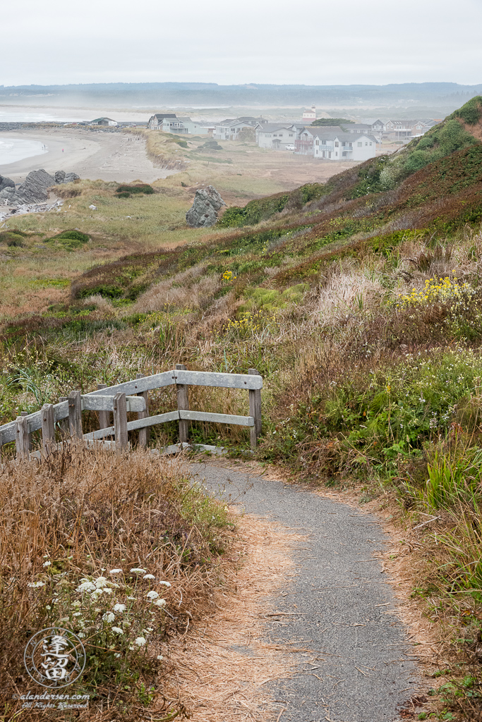 Stairs leading down to the beach at the north end of Kronenberg County Park near the 8th St SW parking area in Bandon, Oregon.