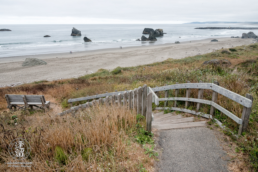 The stairs leading down to the beach at the north end of Kronenberg County Park near the 8th St SW parking area in Bandon, Oregon.