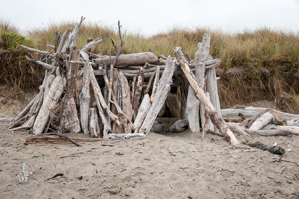Driftwood beach house constructed on the beach near Bandon South Jetty County Park at Bandon, Oregon.